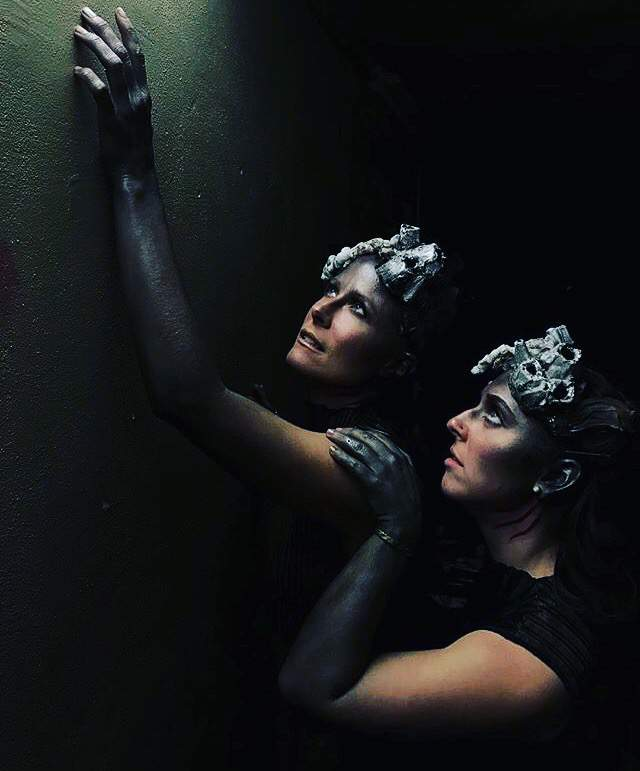 Dancers in full underwater makeup look up. Photo credit Jenn Steigerwald